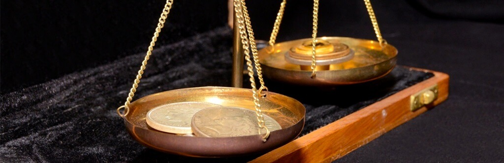 Gold coins on scales