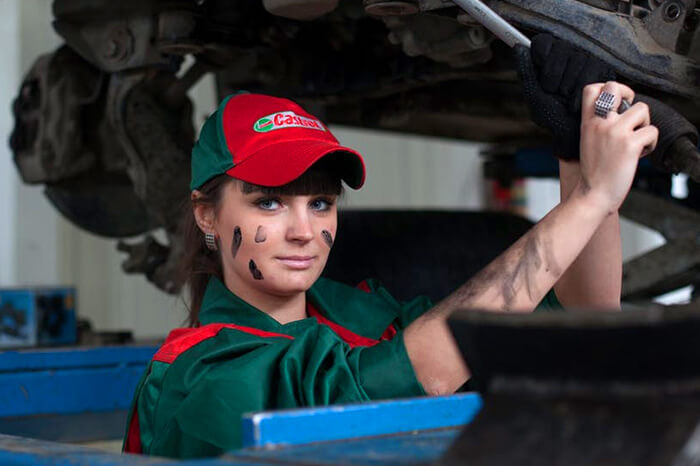 woman changing oil