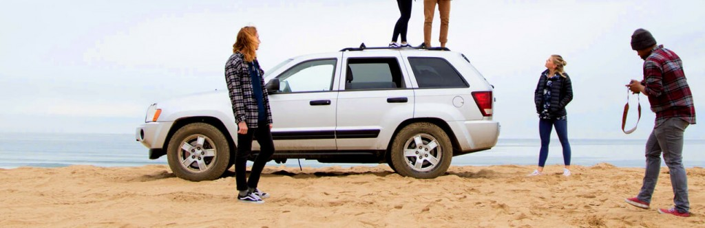 family with suv on the beach